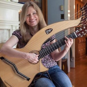 Fingerstyle guitarist Muriel Anderson poses with a harp guitar.
